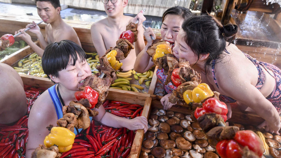 In China, tourists take a broth in the fondue